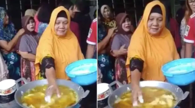 lady dipping hands in hot oil